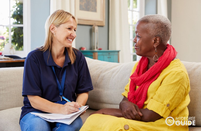 social worker visiting an elderly woman in her home