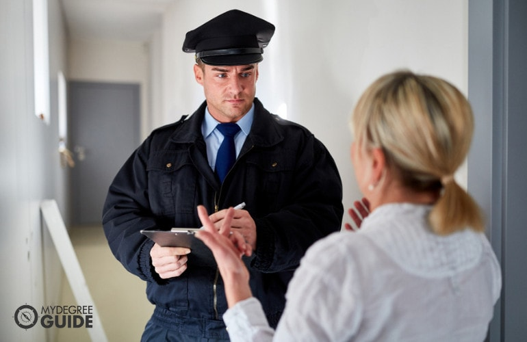 Police officer interviewing a witness