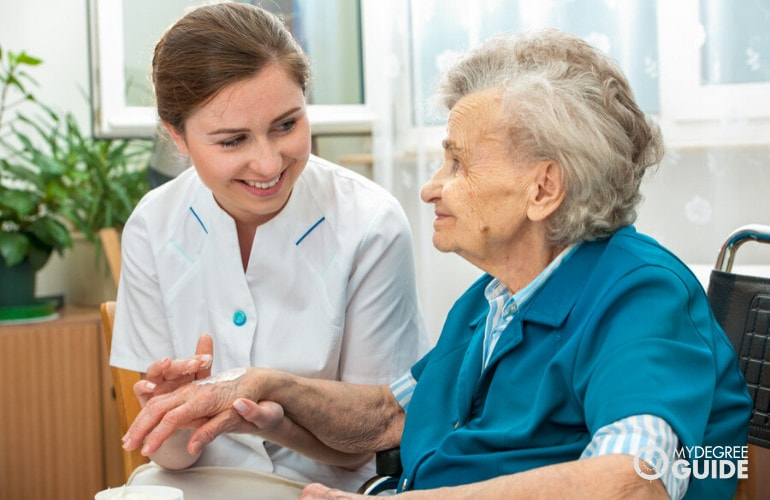 Gerontology Nurse taking care of a senior patient