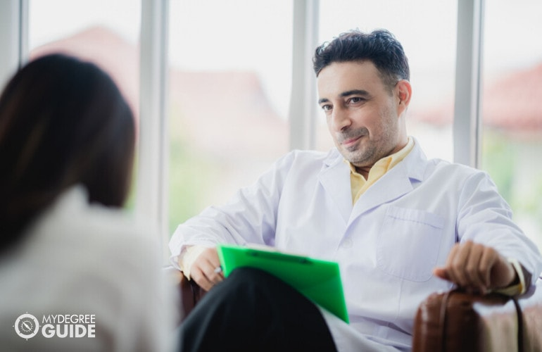 Forensic Psychologist with a patient in his office