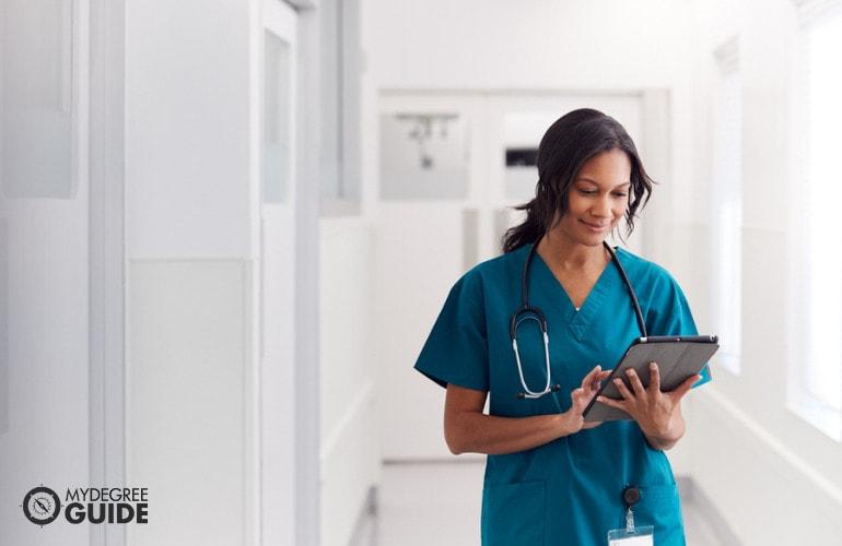 nurse walking in hospital hallway