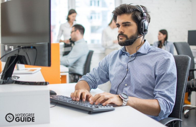 Computer Systems Analyst working in an office