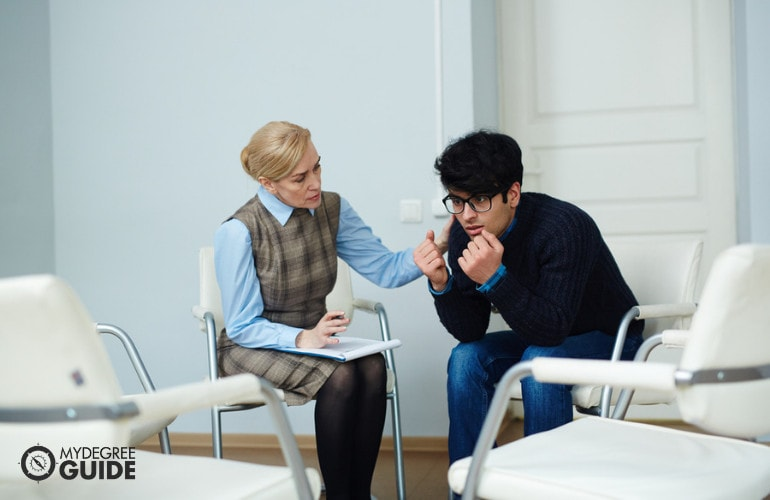 Forensic Psychologist comforting a patient