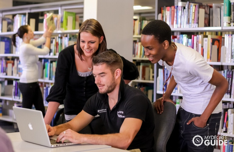 college students in university library