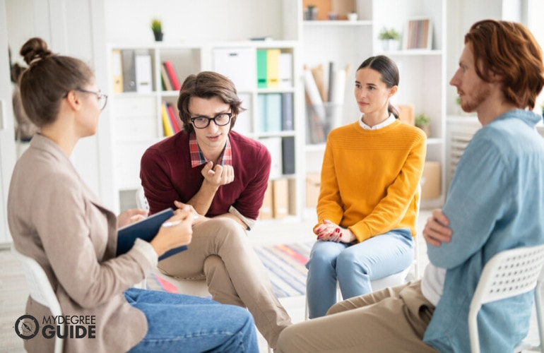 Industrial Organizational Psychologist with company employees during group therapy
