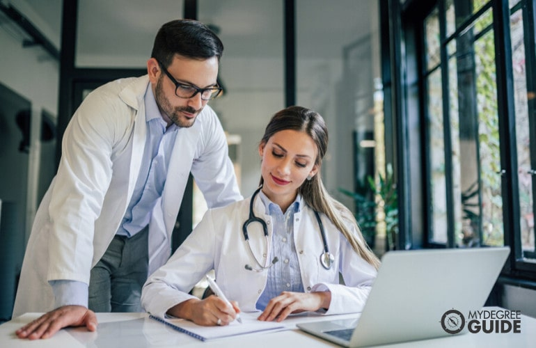 Medical and Health Services Manager meeting with a doctor