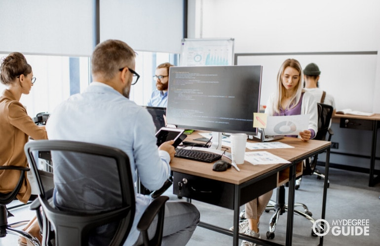 Database Administrators working in the office