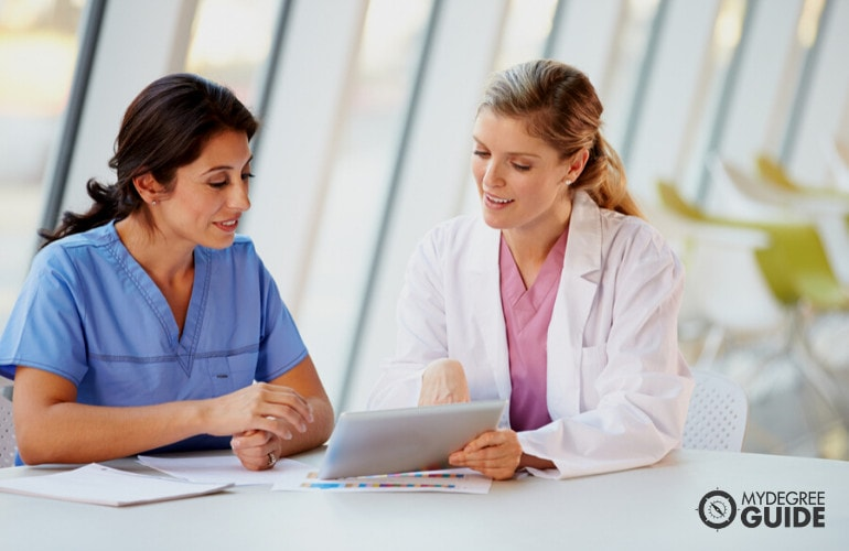 Medical and Health Services Manager meeting with a nurse