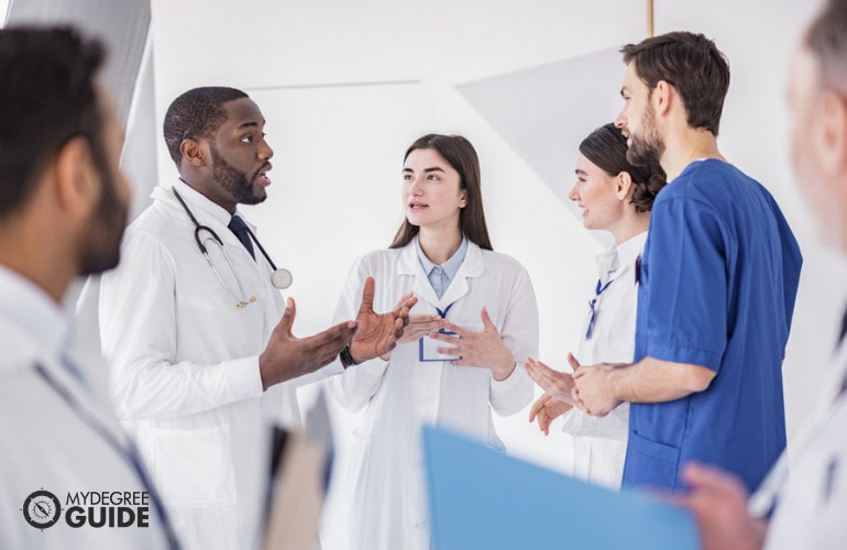 Medical and Health Services Managers in a meeting