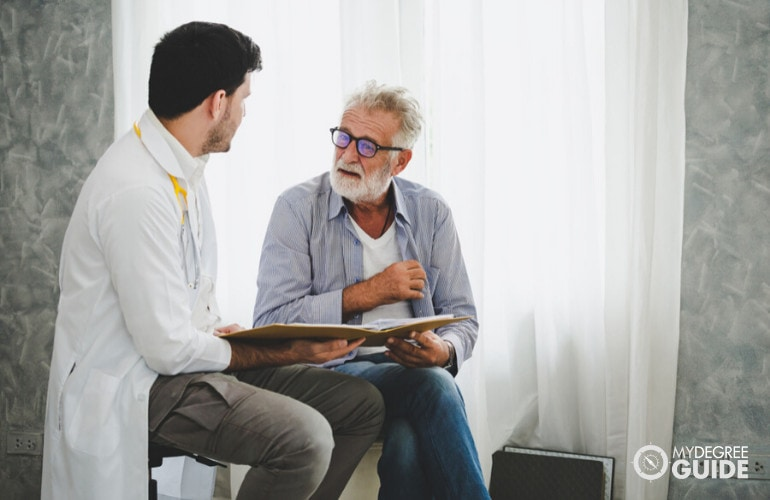 Forensic Psychologists talking to a patient