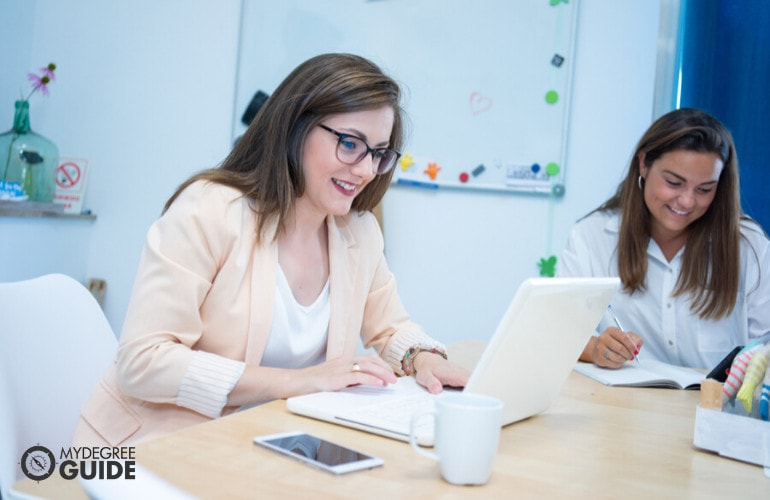 Educational psychologists working in an office