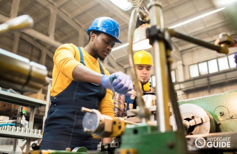 Industrial engineering technicians working together
