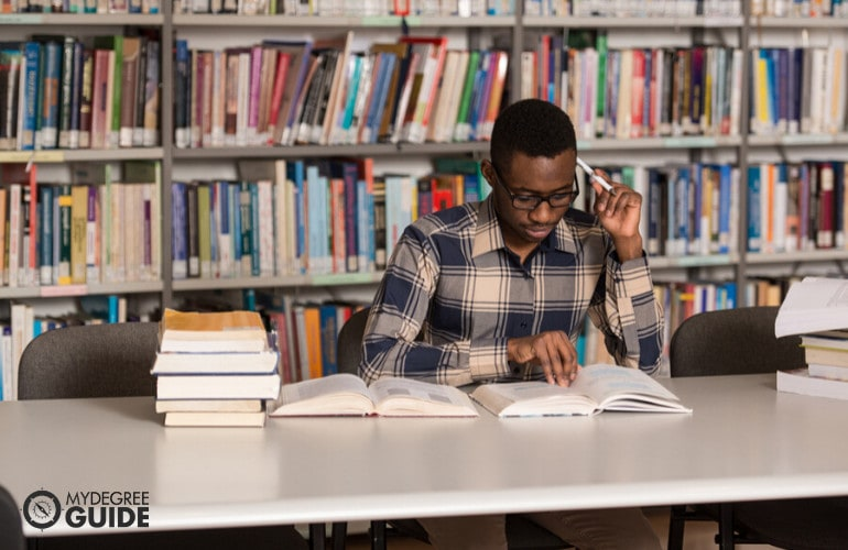 Masters degree student studying in library