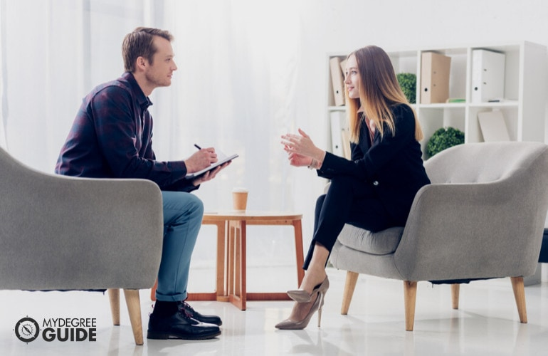 Investigative Journalist with client in an interview