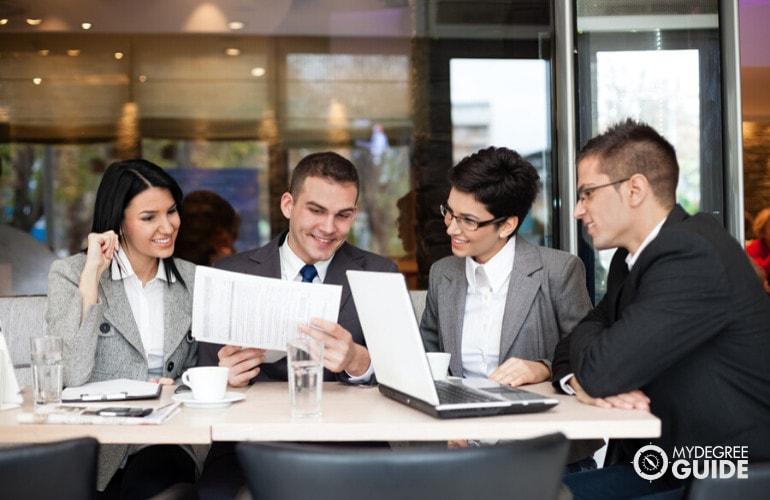 business administrators in meeting