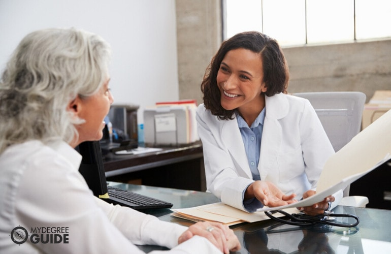 Medical and Health Services Manager with a patient