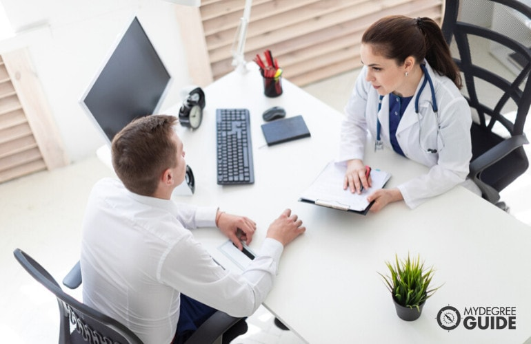 Medical and Health Services Manager with patient