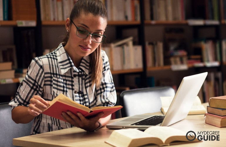 Applied Behavior Analysis student in library