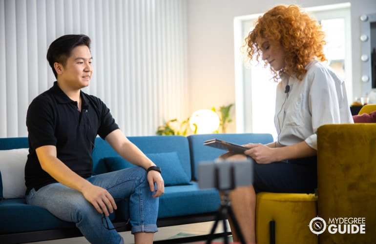 social worker interviewing a man in her office