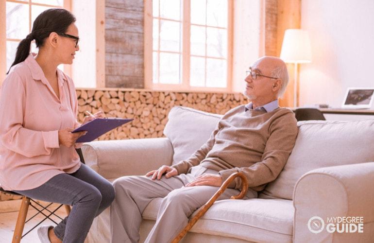 social worker interviewing a man