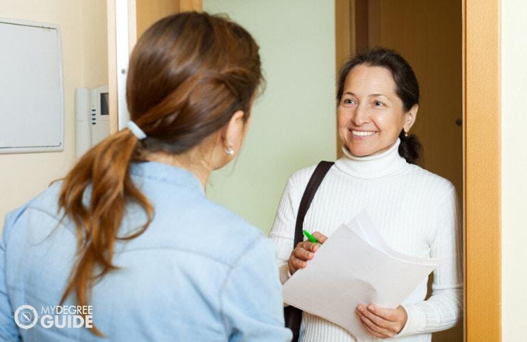 social worker visiting a home